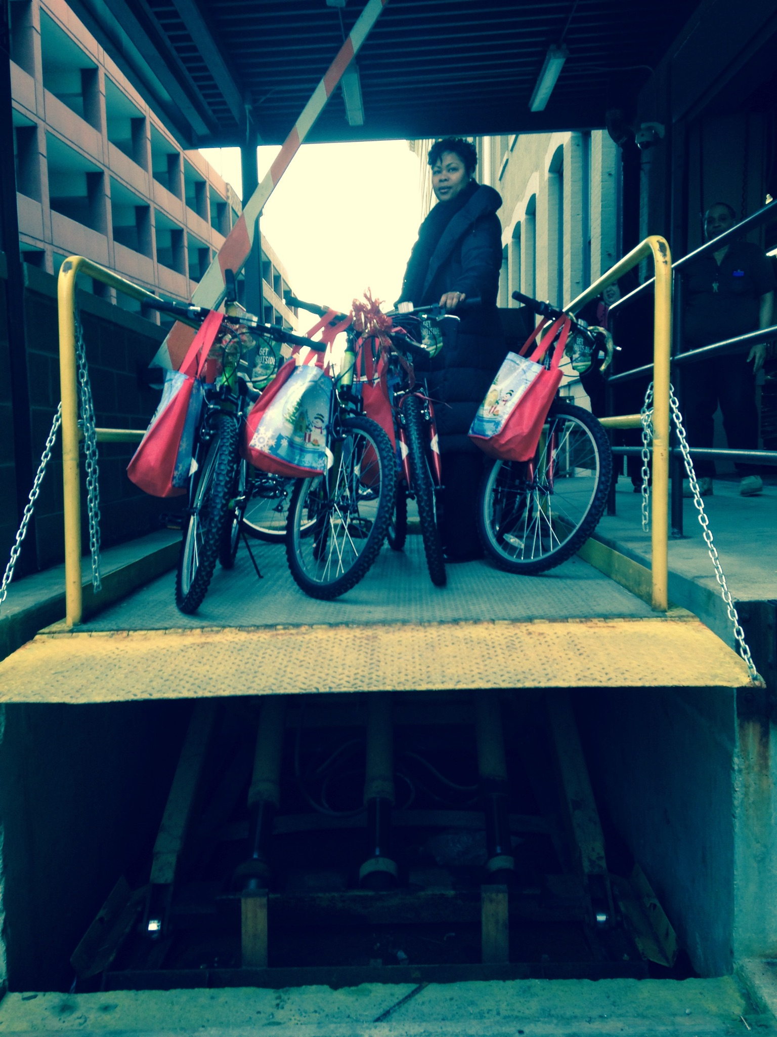 Caseworker Shawnia Robertson helps pack up five bikes.
