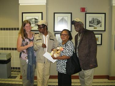 Danielle Varisco (left) joins Zion, Addie and Nathaniel Jones after the adoption for a photo.