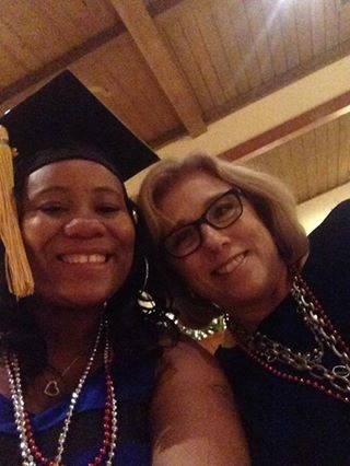 Sandra (left) and Sandy (right) take a picture celebrating Sandra's graduation.